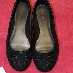 Black slip-ons with lowlight glittering and bow